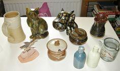 Top to bottom, L-R:  Jane Hamlyn tankard; Cat; Rocket Dog (plastic); Lidded pot and jug by John Jelfs' Bourton-on-the-Water Lazart USA hummingbird;  Lidded pot by David Leach's Lowerdown Pottery; pair of old bottles; Colin Kellam jug.