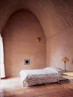 Bedroom—West Texas, Adobe Home—French doors look out to the Mexican Sierra mountains. Simple furnishings allow the strength of the architecture to take center stage.