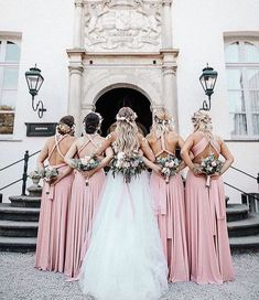 Team Bride What stunning dresses! Love the intricate lace on gown and the dusty rose bridesmaid dresses captured by Tag someone you know who would love this! More dresses on our site link in bio. Wedding Goals, Wedding Pics, Wedding Styles, Dream Wedding, Wedding Day, Spring Wedding, Wedding Ceremony, Dusty Rose Bridesmaid Dresses, Dusty Rose Wedding