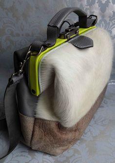 Dokterstas schoudertas koeienhuid geel
