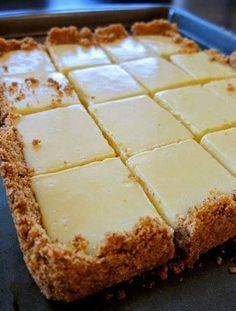 The lemon bars of your dreams take just 15 minutes of prep: Stir together a mere three ingredients to create a sunny, puckery filling for a buttery shortbread crust. FOR THE CRUST 4 tablespoons butter, melted and cooled, plus more for pan 1-1/2 cup graham cracker crumbs 1/4 cup sugar FOR THE FILLING…