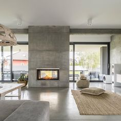 The is a Single-Sided bay style, trimless, electric fireplace by Electric Mo. - The is a Single-Sided bay style, trimless, electric fireplace by Electric Modern proportioned t - Minimalist House Design, Minimalist Home, Modern House Design, Concrete Interiors, Appartement Design, Concrete Floors, Concrete Wall Panels, Concrete Fireplace, Concrete Houses