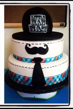 Little Man cake!   Just have a plain white cake made, add ribbon and a paper tie and stache - done and cute! (Put the little mini pennant things on the top?)