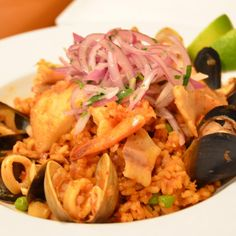 Arroz Con Mariscos (paella) - Fusion Peruvian Grill - Zmenu, The Most Comprehensive Menu With Photos