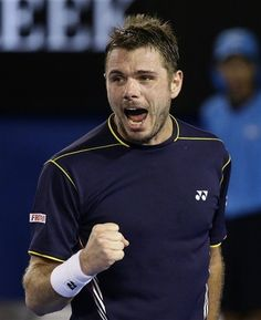 Switzerland's Stanislas Wawrinka reacts during his fourth round match against Serbia's Novak Djokovic at the Australian Open tennis championship in Melbourne, Australia, Sunday, Jan. 20, 2013. (AP Photo/Andy Wong)