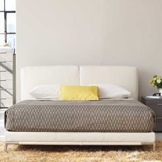 """Our Luna leather bed features a plush padded headboard offering superior comfort that you can relax and lean into. The fully upholstered platform frame keeps the bed neat and unfussy. We love how the polished legs peek out and contrast with the rich leather.  Upholstered in top grain leather  Wood structure,wooden slat system Steel base and legs Queen 64"""" w x 89""""d x 35.5""""h King  79.5""""w x 89""""d x 35.5""""h Made in China Other leathers and fabrics available by special order Exclusively ours"""