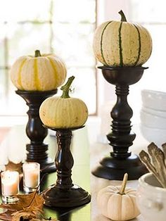 So simple. I have several of these chunky candlesticks that are not in regular use. Candles can be over-done/used, so using the pumpkins instead is a great idea!