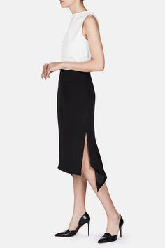 """""""I wanted to be free to follow my curiosity about the world we live in, and weave a tapestry of references and stories into this collection,"""" says Joseph Altuzarra of his fall 2016 range. The designer infused fluidity into his sleek signature—the side-slit pencil skirt—with this softly draped style. Accentuated by flattering vertical seaming at front and back, it has front pockets and angled side slits that highlight the hankerchief hem. A silky lining and concealed back zipper closure…"""