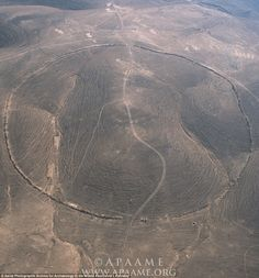 A total of eight big circles have been recorded in west central Jordan, between the Wadi el-Hasa and the edge of the Shara escarpment. There is also a second group, made of four Big Circles, just north of Azraq Oasis. Pictured is circle J1, known locally as Qasr Abu el-Inaya. Dating is problematic, but there is often material in or around the circles that originated in the Chalcolithic and Early Bronze Age, between 2,000 to 4,500 BCE.