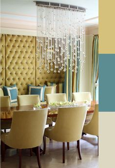 Contemporary Crystal Chandelier in a Traditional Dining Room