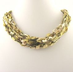 Free Crochet Pattern - Ladder Ribbon Necklace Like this idea with a novelty yarn.