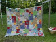 I made this quilt for the beach.  I needed a big one for our size family, so it's about the size of a twin sheet but wider.  It's lined with an old wool blanket and backing is insulated material.  The front squares are just scraps of fabric that I had in storage.