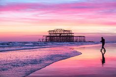 Brighton's West Pier at low tide and dusk by lomokev
