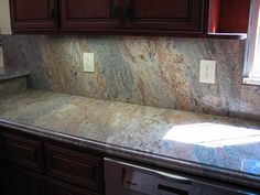 Hi all, Does anyone have any pictures of a full granite backsplash? I have seen one picture on here and it is beautiful. I have planned my kitchen around a tile backsplash, possibly glass. Although the one full granite backsplash I have seen is beautiful. I am wondering why most people don't do it. ...
