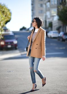 Loving this fall street style from 9 to 5 Chic. She pairs our camel double-breasted blazer with a striped sweater, distressed denim, and pumps | Banana Republic