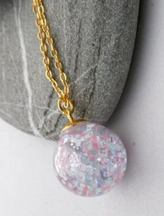 White, Pink, and Blue Pastel Glitter Snow Globe Necklace