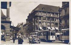 Uliczny ruch na ul. Świdnickiej, w centrum kadru dom handlowy Juliusa Schottländera. 1932 r.