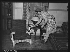 Fruit farmer's wife in her living room. Placer County, California 1 negative : safety ; 3 1/4 x 4 1/4 inches or smaller.      Contributor: Lee, Russell     Original Format: Photos, Prints, Drawings     Date: 1940