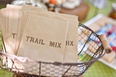 Printable Bag Design- Trail Mix buy these and have a huge bowl of trail mix for folks to scoop and take what they want for a snack...on the drive home? Not sure when you'd serve it.