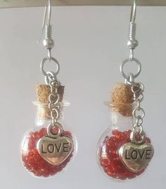 Check out this item in my Etsy shop https://www.etsy.com/listing/498024934/love-red-seed-bead-heart-glass-vial