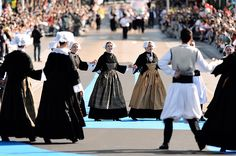 Performers in traditional folk costumes take part in a Breton dance during the Festival Interceltique de Lorient in the seaport of Lorient, France, on August 5, 2012. The Celtic-themed festival runs from August 3 to 12, 2012.