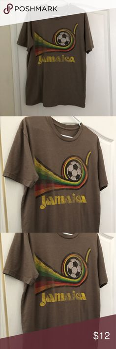 Men's size medium Jamaica soccer tshirt Men's size medium Jamaica soccer tshirt. Try finding this one in a store. No rips holes stains or tears very good preworn condition. If your heart calls out to the sensual wonder of Caribbean paradise and soccer, this is the shirt for you. Matter of fact, you should wear it on your honeymoon. Leap out of the closet, and shock your bride with your incredible style. boston 77 Shirts Tees - Short Sleeve