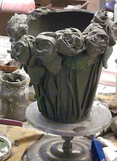 an old cotton sheet ripped into strips then dipped in slip and creatively twisted into stylized roses are attached to a This could easily be done over a terra-cotta pot using cement Cement Art, Concrete Cement, Concrete Crafts, Concrete Projects, Concrete Garden, Concrete Planters, Ceramic Techniques, Pottery Techniques, Concrete Leaves