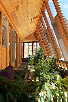 View from inside an earthship home. the Earthship is the epitome of sustainable design and construction. No part of sustainable living has been ignored in this ingenious building. Earthship Design, Earthship Biotecture, Earthship Home, Natural Building, Green Building, Model Building, Earth Homes, Sustainable Living, My Dream Home