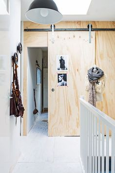 Sliding wood door on tracks in the fuss-free and laid back Dutch home of Marieke…