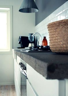 Near-black stained butcher block countertops.