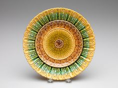 Schramberg Majolica Factory, manufacturer, German, 1820-1989; In the style of Christopher Dresser, designer, Scottish, 1834-1904. Cake Plate, late 19th century. Earthenware with glaze. Height: 2.5 cm (1 inches). Gift of Glenn Gissler 2013.86.5