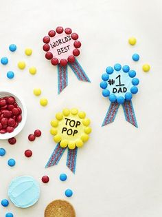 Show Pop he takes top honors with a blue ribbon Father's Day dessert. Generously cover a round cookie (ours were about 2 inches wide) with tinted frosting. Press on M