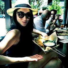 Meghan Markle.. Helmut Lang top, Eliza and James shorts, Glasses, Ltd sunglasses, and Madewell hat..