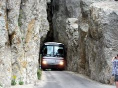 Another view of tour bus negotiating the tunnels on the Needles Highway, Custer State Park, South Dakota.