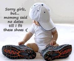 Baby boy in dad's shoes