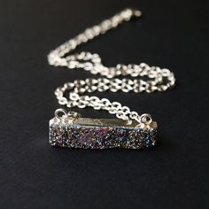 A dainty druzy bar that falls right at the collarbone. This necklace is delicate and perfect for laying with other necklaces! The druzy Bar Necklace comes standard on a 15 chain but if you would like something longer or shorter just leave a note when checking out. This item comes wrapped