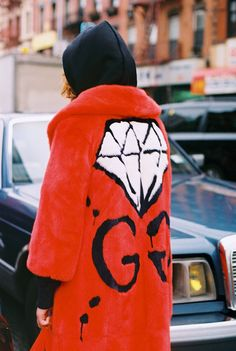 Mallory Merk, 15, a singer and model, wears a GucciGhost GG Diamond plush coat. Produced by Vogue for Gucci.