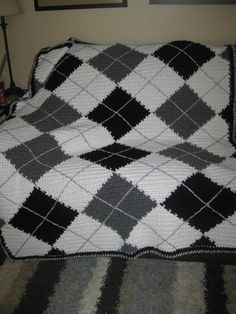 Crocheting Ideas | Project on Craftsy: More Argyle. I bet I could make a similar one by piecing together big squares and then adding the thin grey lines once the blanket is done.