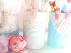 Painted tin cans with pasted doily