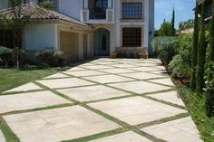 Stamped concrete driveway with grass strips