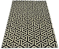 """A custom hand tufted New Zealand wool rug in jet black and ivory white. It has a pile depth of 10-12mm. Created using the """"Triform"""" design. #CustomRugRoom"""