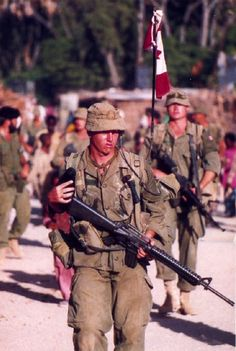 A paratrooper from No 3 Commando Canadian Airborne Regiment patrol at Belet Uen Somalia The conduct of the paratroopers in Somalia eventually led to CAR's disbandment x