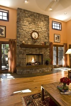 Stone fireplace with wood beam mantel
