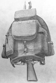 1940's Swiss Army canvas mountain rucksack with bread bag, ammunition case, piton (ice axe), K31 rifle, and wool bivouac blanket.