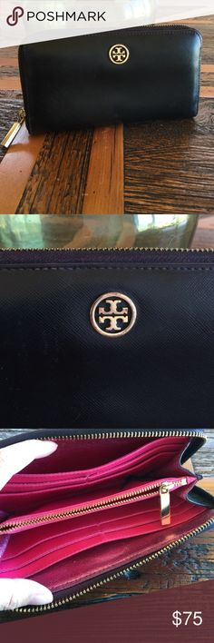 Tory Burch wallet black w plum accent color! 💘 4.5X7.5 zip around wallet. Color is a Black w Dark Plum accent and bright pink lining inside. This wallet is used and there are signs of usage. The lining inside has pen stains. Tory Burch Bags Wallets