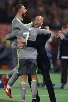 Cristiano Ronaldo celebrates with Sergio Ramos and Zinedine Zidane after scoring during the UEFA Champions League football match AS Roma vs Real Madrid