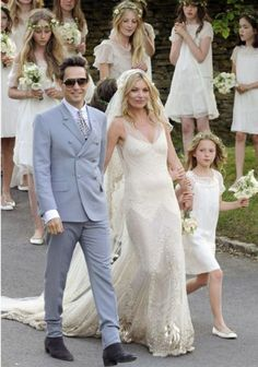Kate Moss' wedding gown, sheer bias-cut with gold beading by John Galliano