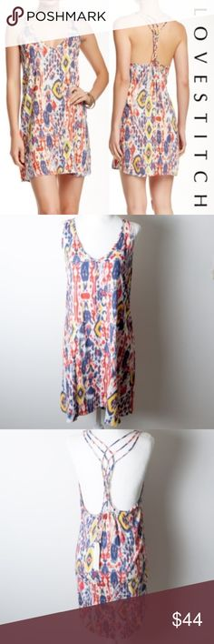 NWT Love Stitch Tie Dye Diamond Graphic Pattern New with tags Love Stitch dress in medium. Multicolored tie dyed diamond pattern dress. V-neck, sleeveless, woven racerback. Blue, white red and yellow.  tags - sexy, hobo, date night, girls night, going out, summer, vacation, colorful, allover print, bright, lightweight, strappy, party, occasion, cute dresses, graduation dresses Love Stitch Dresses Mini