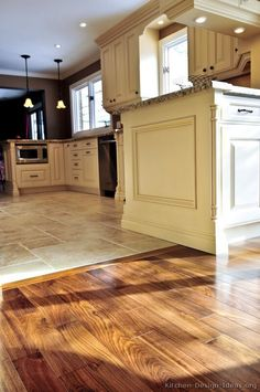 #Kitchen Idea of the Day: Perfectly smooth transition from hardwood flooring to tile floors in an open-plan kitchen....