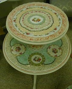 Mozaic 2-shelf pie-crust table. Gorgeous! probably made out of old ceramic plates and dishes......?